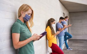 Consumers practicing social distancing while using mobile phones